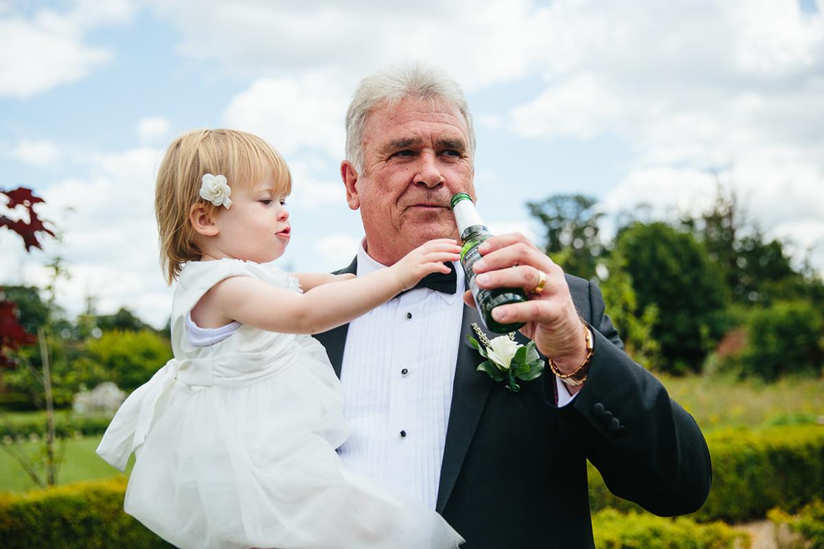 WEDDING PHOTOGRAPHY SECRET GARDEN ASHFORD KENT CHILD REACHING FOR BEER