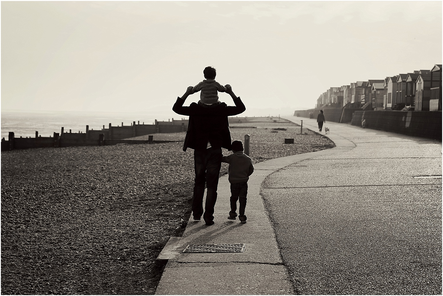 Whitstable beach photography family child silhouette black and white father and sons