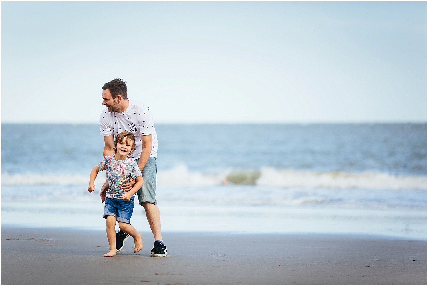 boy with father on sunny sands beach folkestone kent family photography