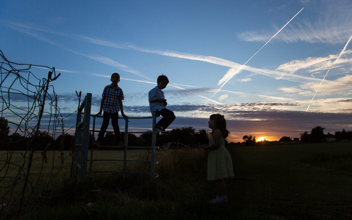 lower grange farm wedding photographer kids at dusk silohuette