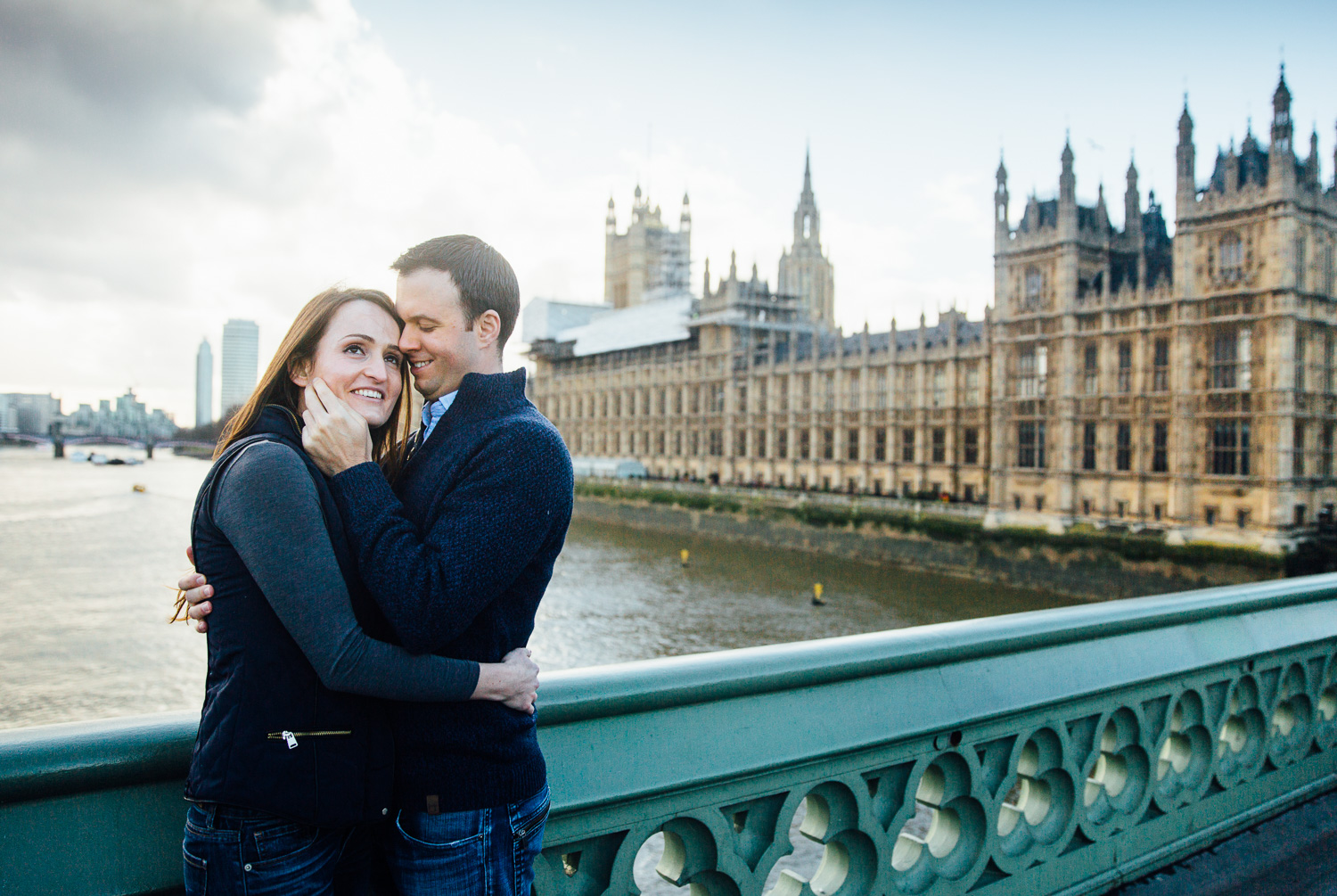 couple on bridge with london in background. Engagement photography london.