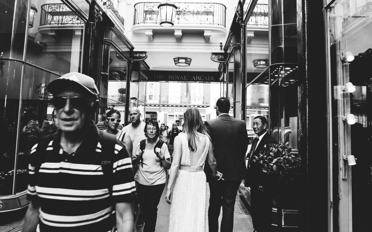 Browns hotel wedding photographer. Bride and Groom on London street. Burlington Arcade.