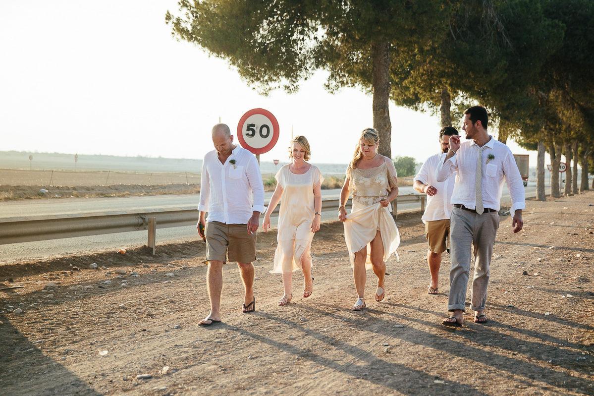 WEDDING BRIDAL PARTY BRIDE AND GROOM WALKING IN SUNSHINE COSTA BLANCA WEDDING