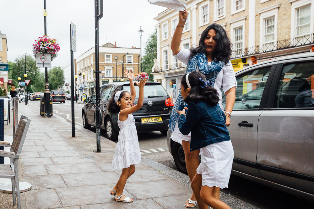 FAMILY AND CHILDRENS PHOTOGRAPHER ST JOHNS WOOD LONDON, FAMILY PLAYING ST JOHNS WOOD HIGH STREET