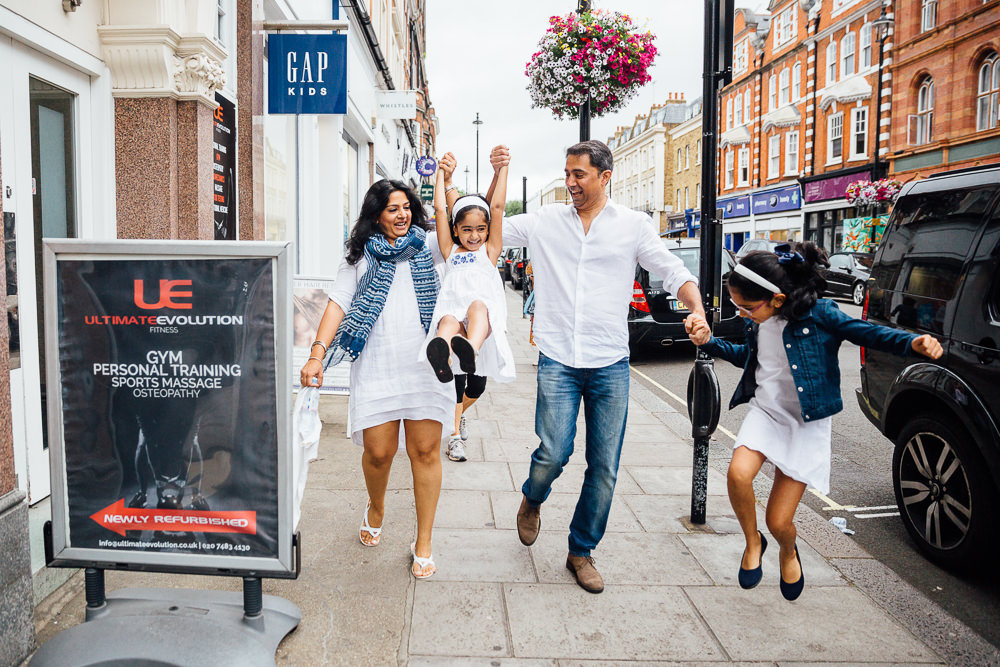 FAMILY AND CHILDRENS PHOTOGRAPHER ST JOHNS WOOD LONDON, FAMILY PLAYING ON HIGH STREET