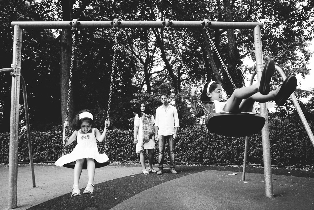 CHILDREN ON SWINGS IN PARK, FAMILY AND CHILDRENS PHOTOGRAPHER ST JOHNS WOOD LONDON