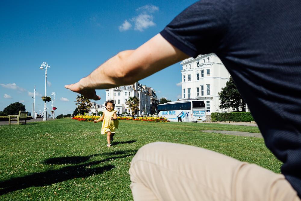 girl running towards father, folkestone, kent, photography