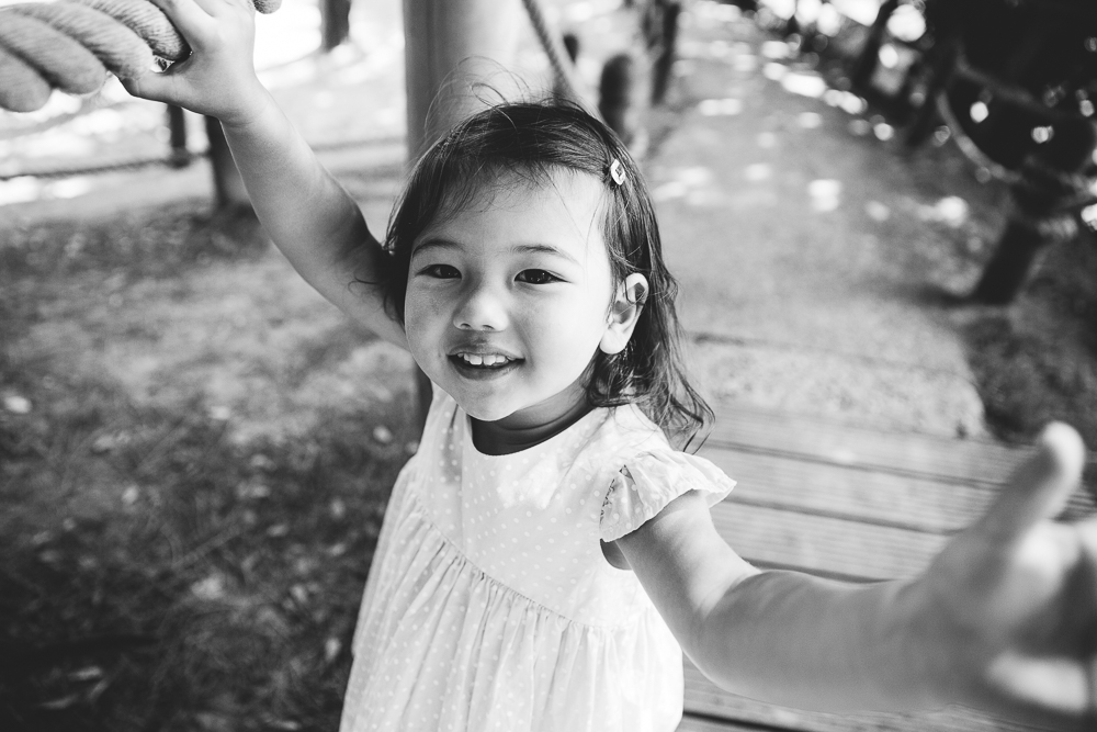 family photography of toddler girl playing at the coastal park, folkestone, kent
