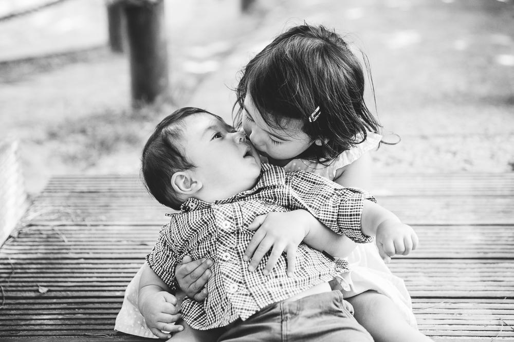 baby boy and toddler girl sister portrait at the coastal park, folkestone, kent
