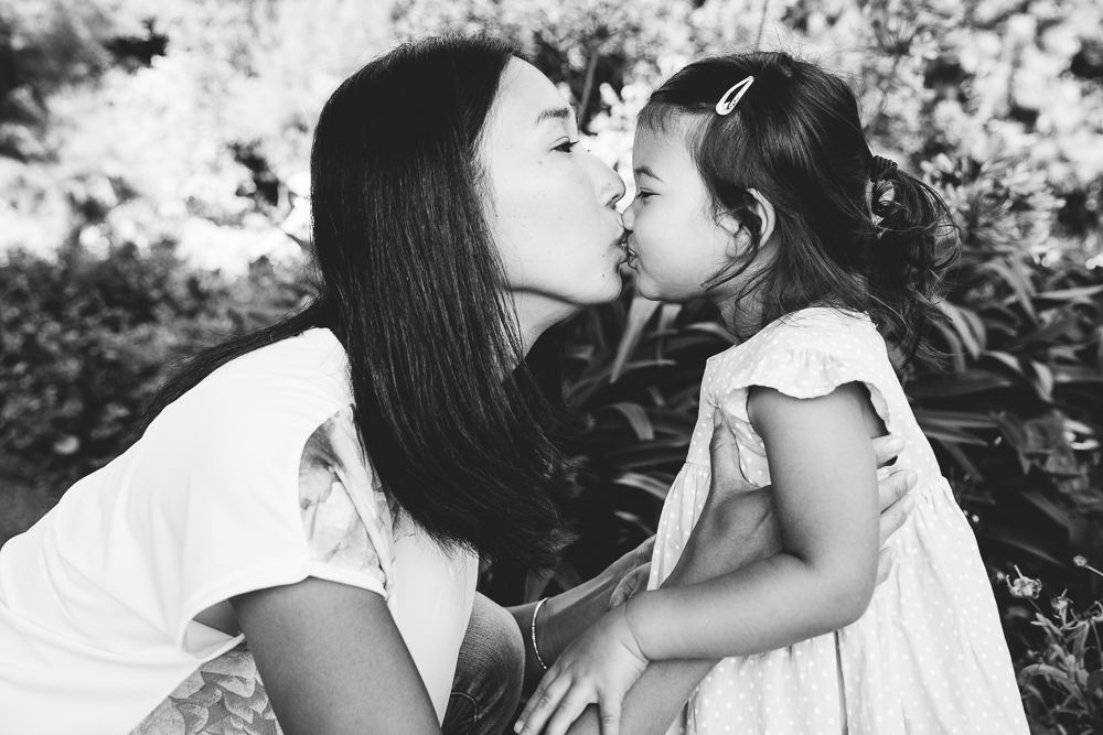 family photography of toddler girl kissing mother at the coastal park, folkestone, kent