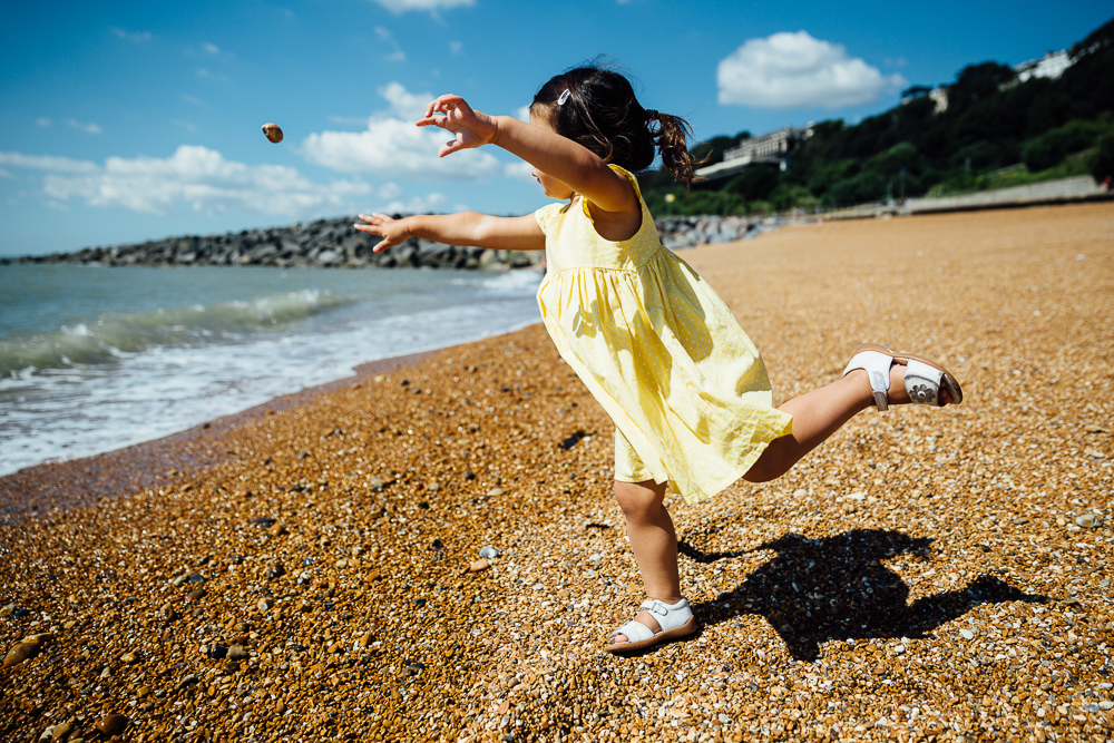 family photography of toddler girl playing at the beach, folkestone, kent