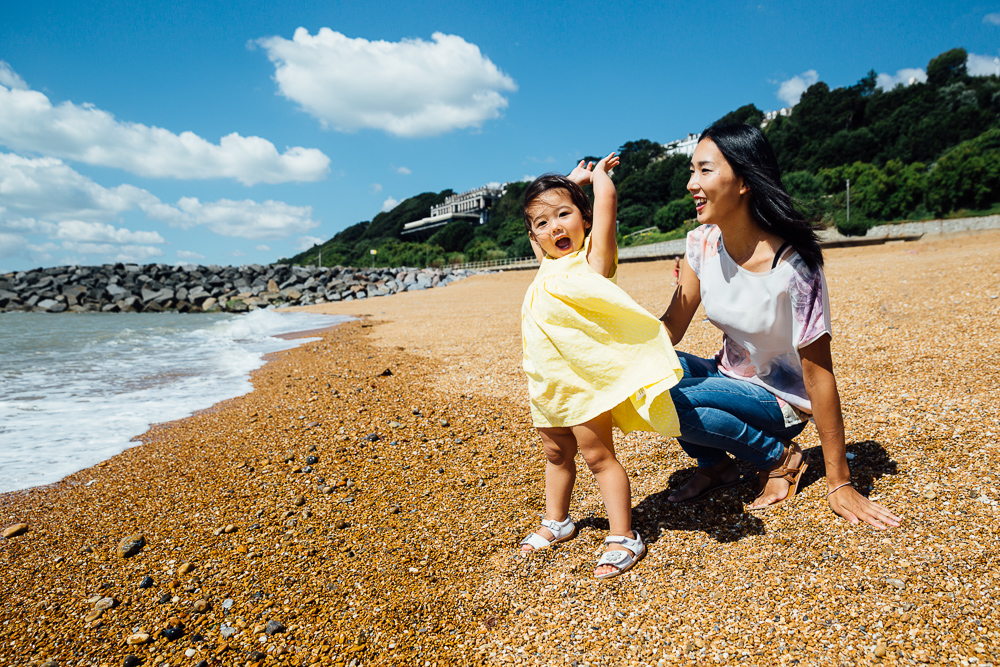 family photography of toddler girl and mother playing at the beach, folkestone, kent