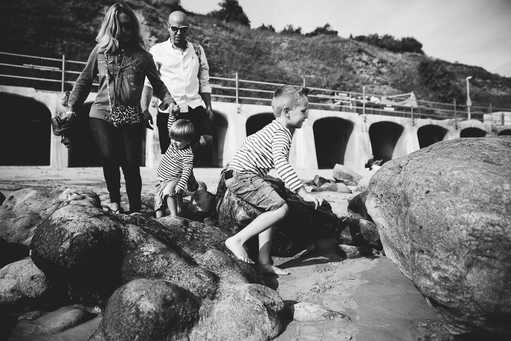 family playing on sunny sands beach folkestone - Family Photographer Kent