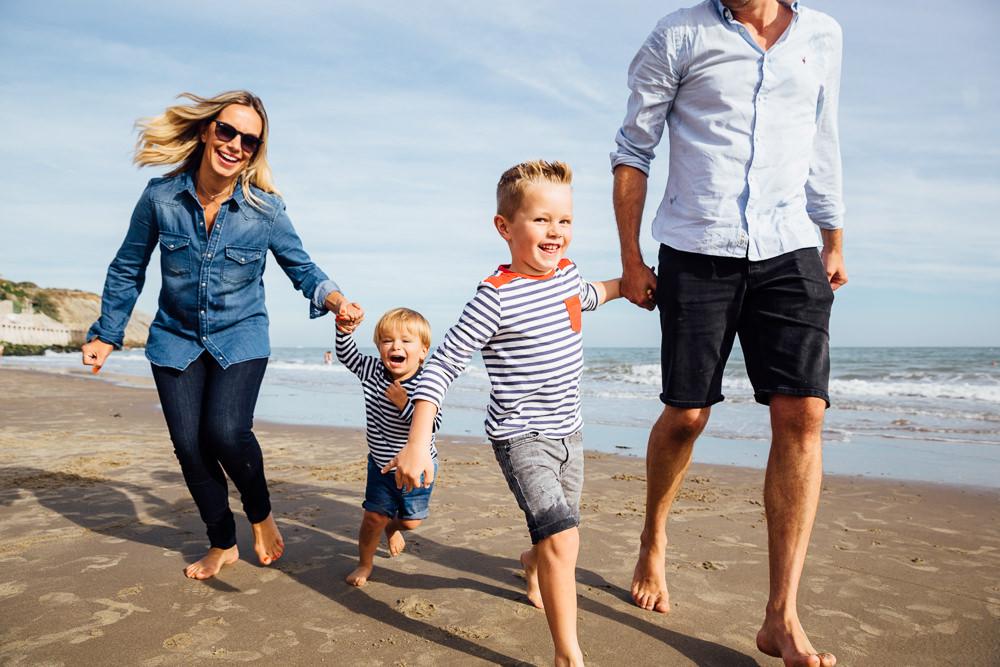 family playing sunny sands beach folkestone - Family Photographer Kent