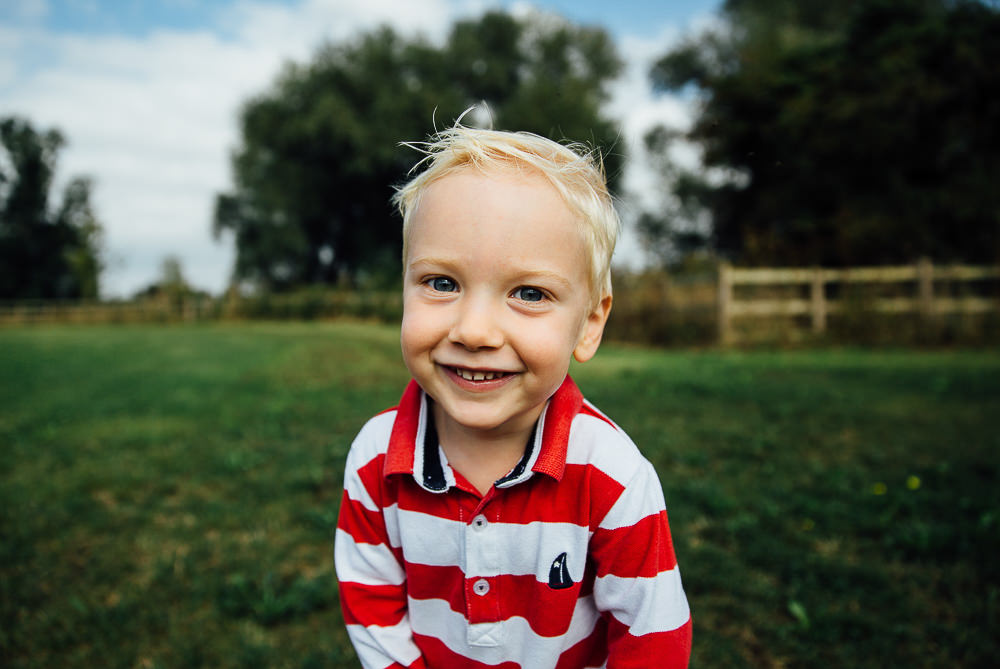 BLONDE LITTLE BOY SMILING IN PARK - KENT FAMILY PHOTOGRAPHER