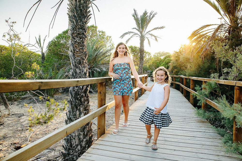 SISTERS ON BEACH BOARDWALK COSTA BLANCA - SPAIN FAMILY PHOTOGRAPHER