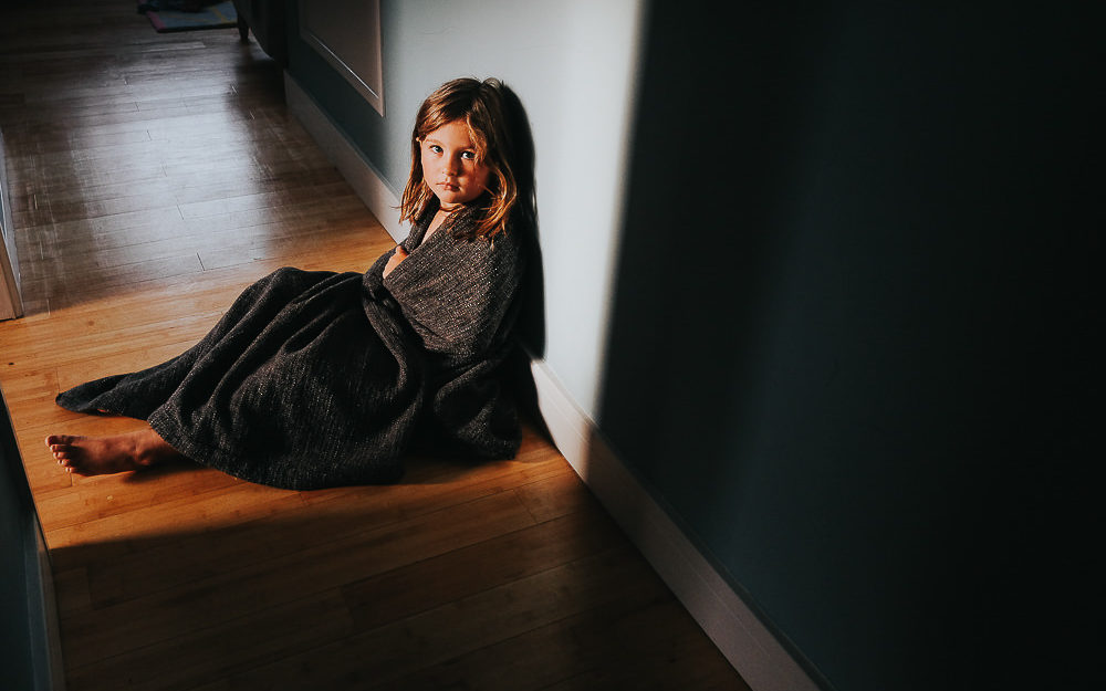 GIRL IN BLANKET STRONG SUNLIGHT - KENT FAMILY PHOTOGRAPHER