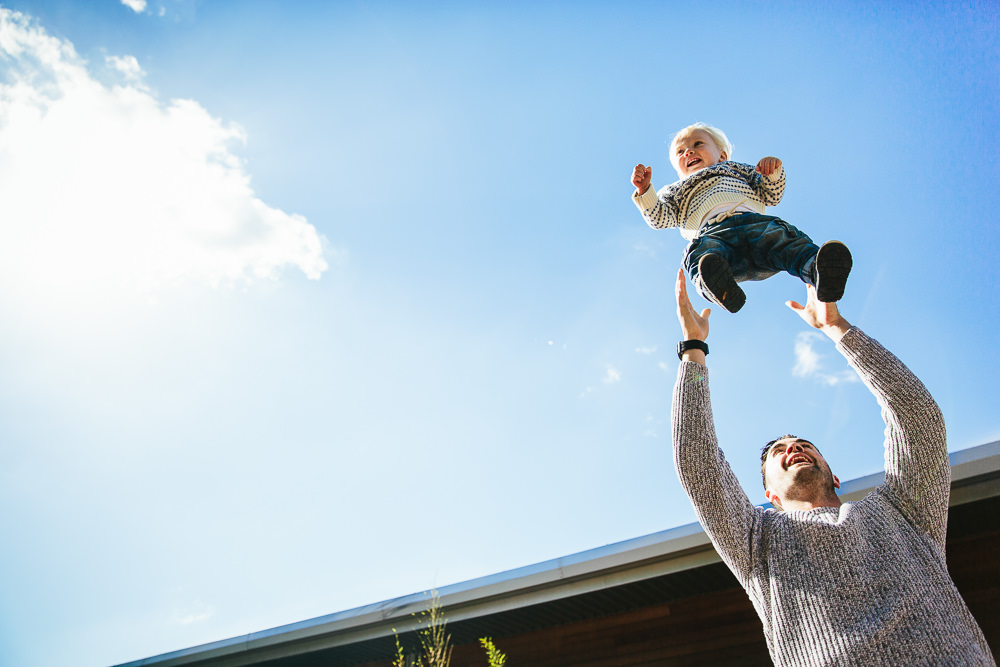 BABY BOY BEING THROWN IN AIR BLUE SKY - KENT FAMILY PHOTOGRAPHER