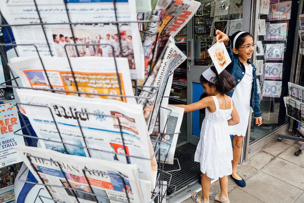 KIDS CHOOSING A CARD IN NEWSAGENT - KENT FAMILY PHOTOGRAPHER