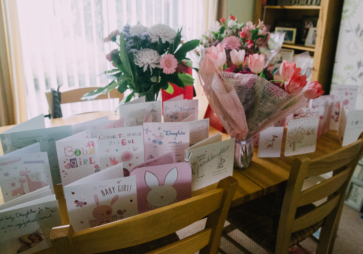 NEW BABY CARDS AND BUNCHES OF FLOWERS