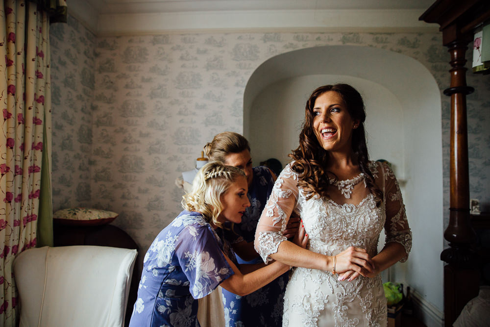 dressing the bride bilsington priory kent wedding photographer