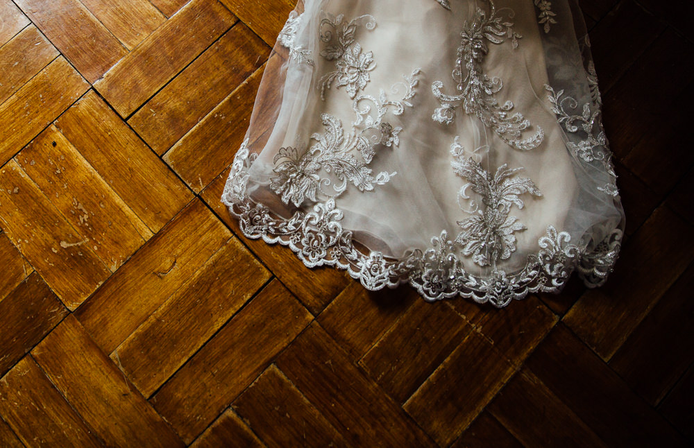 wedding dress train on wooden floor bilsington priory kent wedding photographer