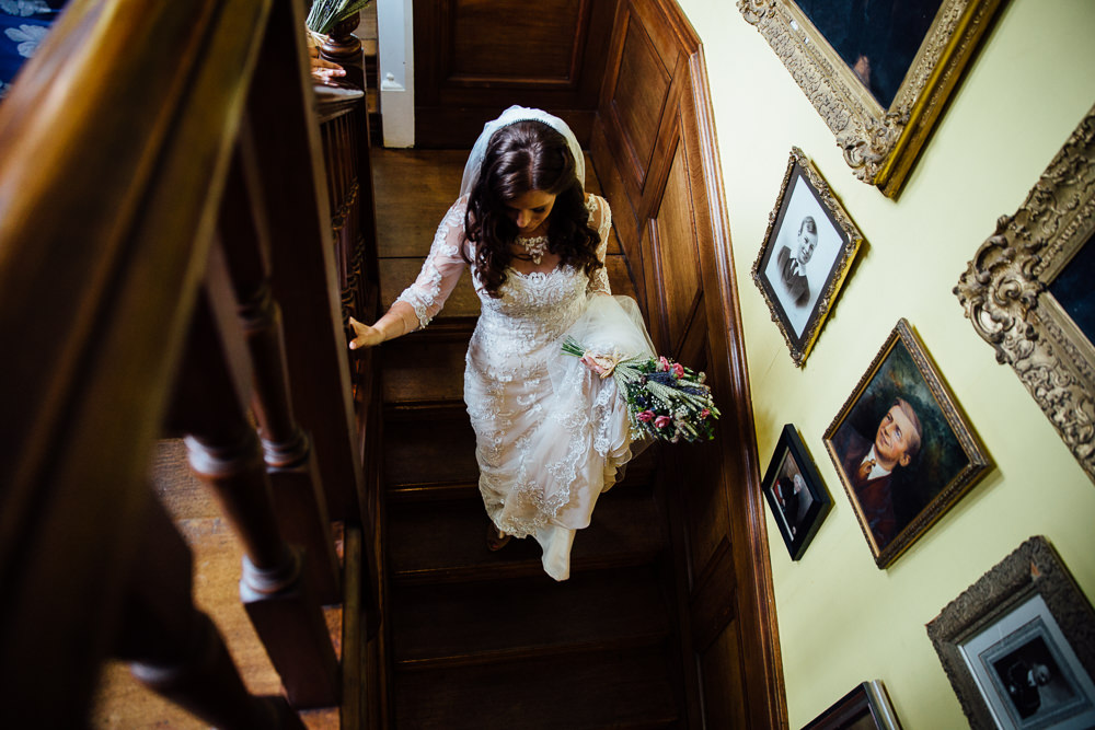 bride walking down stairs aerial shot bilsington priory kent wedding photographer