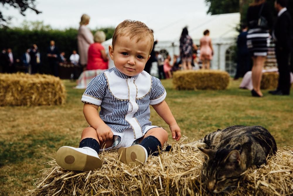 baby boy on hay bale bilsington priory kent wedding photographer