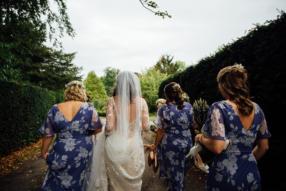 bride and ASOS bridesmaids walking bilsington priory kent wedding photographer
