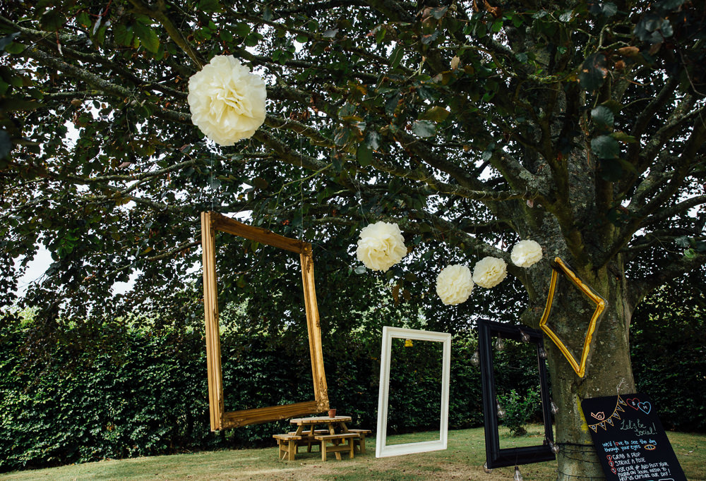 hanging photo frames in trees bilsington priory kent wedding photographer