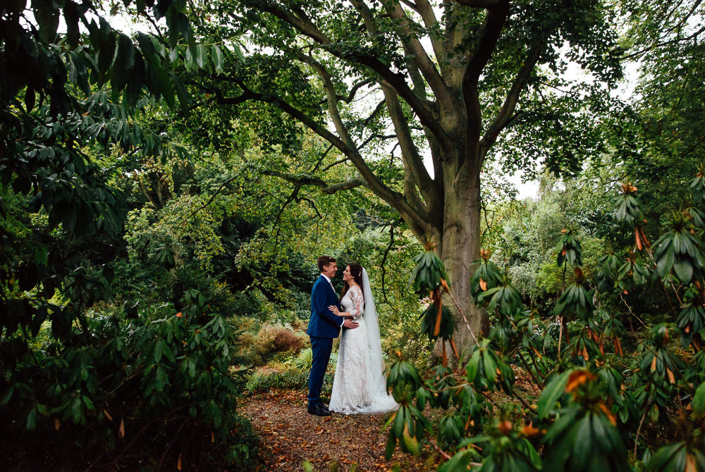 bride and groom garden portrait bilsington priory kent wedding photographer