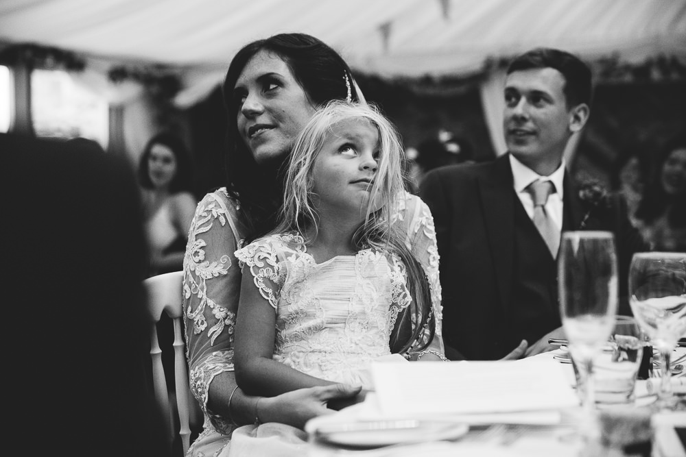 bored bridesmaid during speeches bilsington priory kent wedding photographer