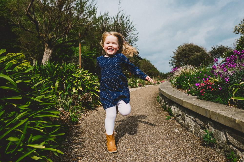 GIRL RUNNING BEACH PORTRAIT KENT FAMILY PHOTO SHOOTS