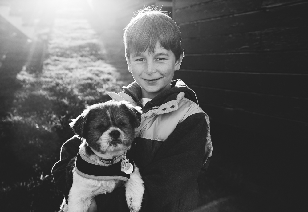 BLACK AND WHITE BOY AND DOG PORTRAIT KENT FAMILY PHOTO SHOOTS