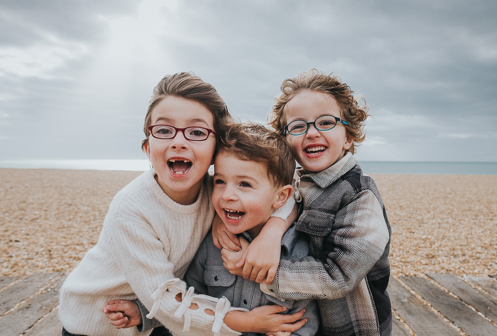 THREE SIBLINGS BROTHERS SISTERS FAMILY PHOTOGRAPHER KENT AND LONDON BEACH PORTRAIT FOLKESTONE