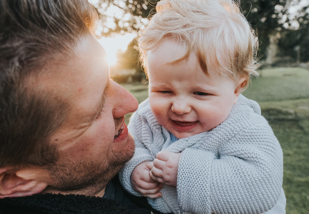 FATHER AND BABY SON BACK LIT FAMILY PHOTOGRAPHER KENT AND LONDON PORTRAIT GODMERSHAM