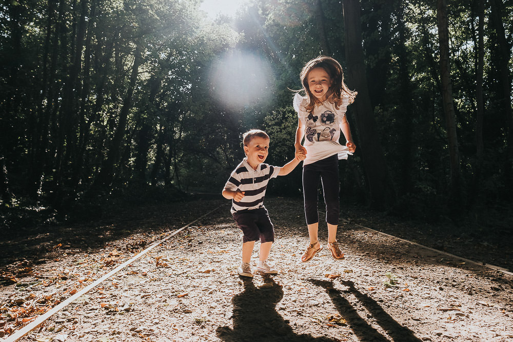BROTHER AND SISTER SIBLINGS WOODLAND FAMILY PHOTOGRAPHER KENT AND LONDON PORTRAIT BACKLIT MAIDSTONE