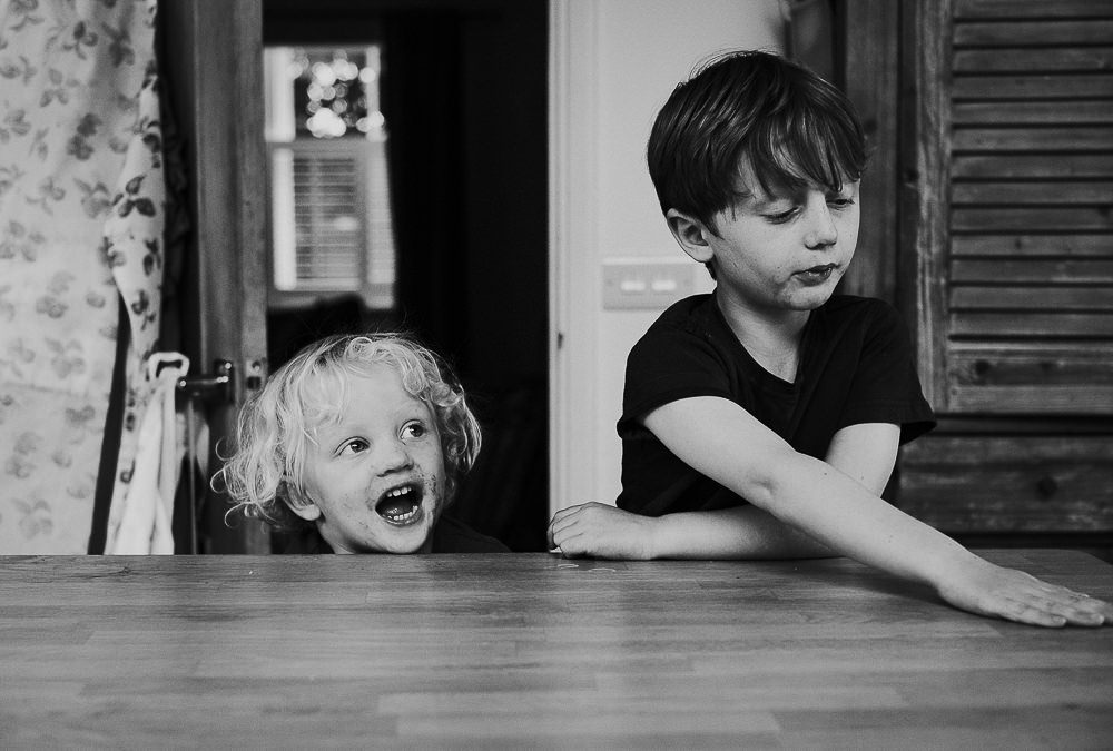 BLACK AND WHITE DAY IN THE LIFE WHITSTABLE FAMILY PHOTOGRAPHER KENT AND LONDON BROTHERS PORTRAIT CHEEKY