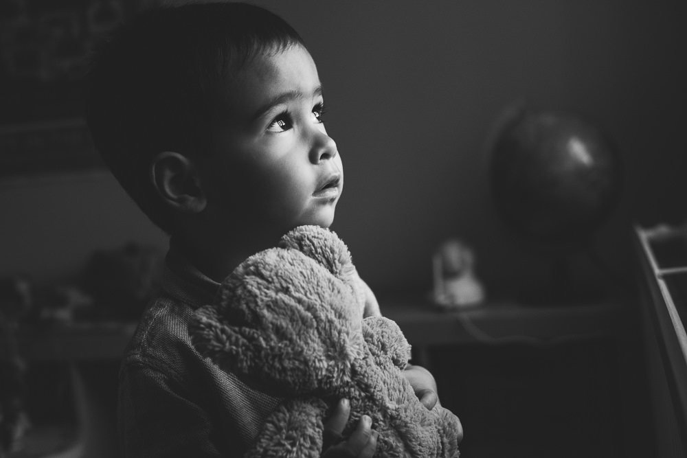 BLACK AND WHITE WINDOW LIGHT PORTRAIT BOY WITH BEAR GODMERSHAM FAMILY PHOTOGRAPHER KENT AND LONDON