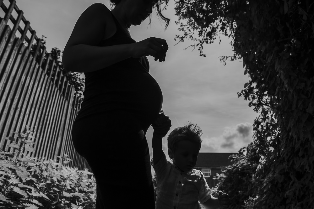 MATERNITY FAMILY PHOTOGRAPHER KENT AND LONDON MAIDSTONE SILHOUETTE PREGNANT WOMAN WITH SON