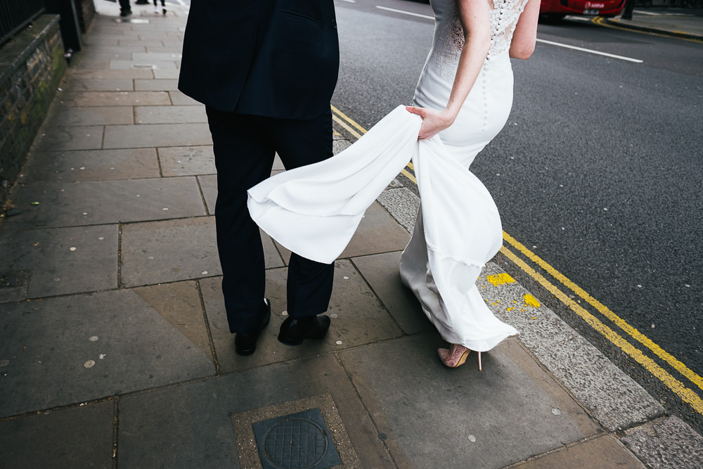 KENT PHOTOGRAPHER CHELSEA REGISTRY OFFICE WEDDING PHOTOGRAPHY BRIDE DOUBLE YELLOW LINES