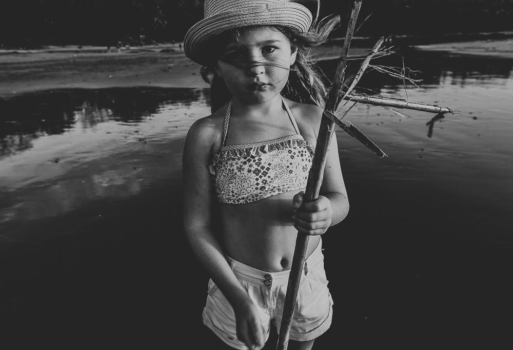 KENT PHOTOGRAPHER COSTA RICA TRAVEL PHOTOGRAPHY BLACK AND WHITE GIRL PORTRAIT ON BEACH PLAYA PELADA