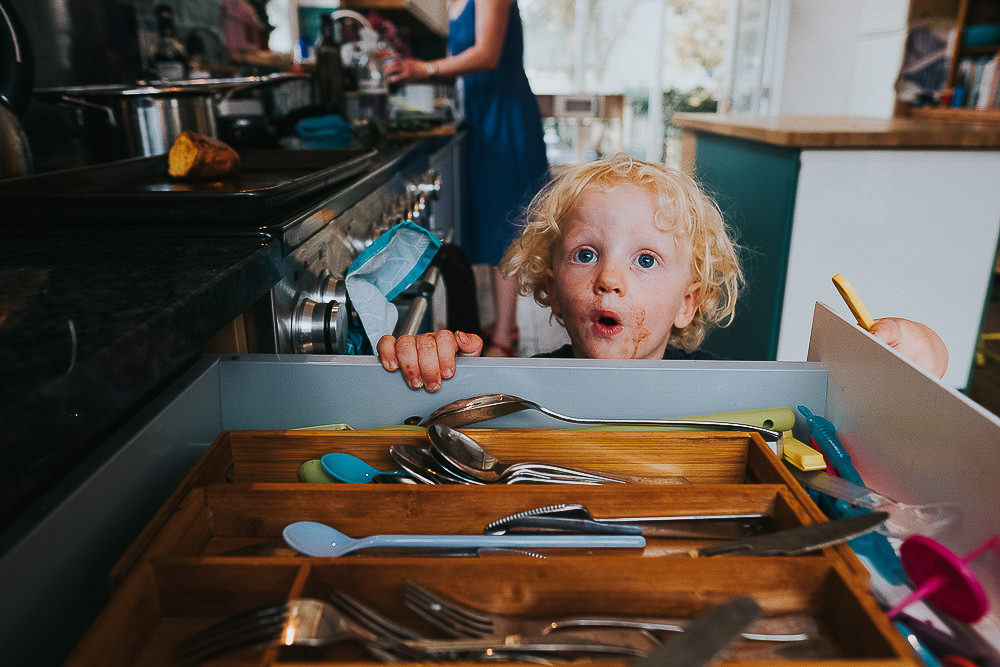 KENT PHOTOGRAPHER DAY IN THE LIFE FAMILY PHOTOGRAPHY WHITSTABLE BOY IN CUTLERY DRAWER