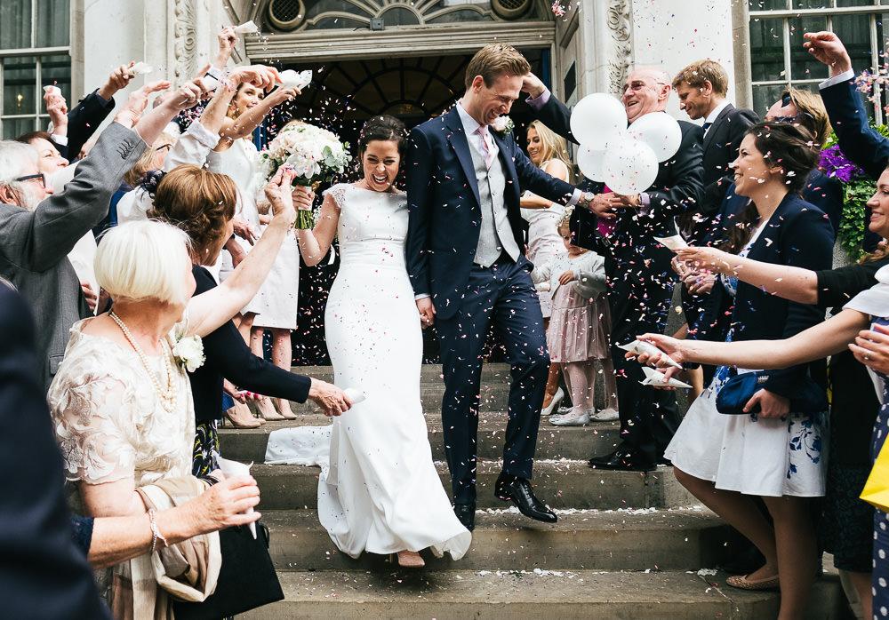 KENT PHOTOGRAPHER CHELSEA BLUEBIRD WEDDING PHOTOGRAPHY CONFETTI STEPS LONDON
