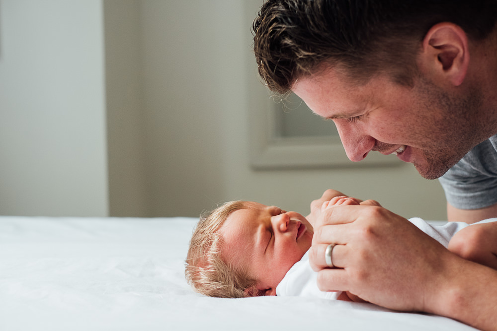 NEWBORN PHOTOGRAPHER LONDON AND KENT FATHER AND BABY SON ON BED