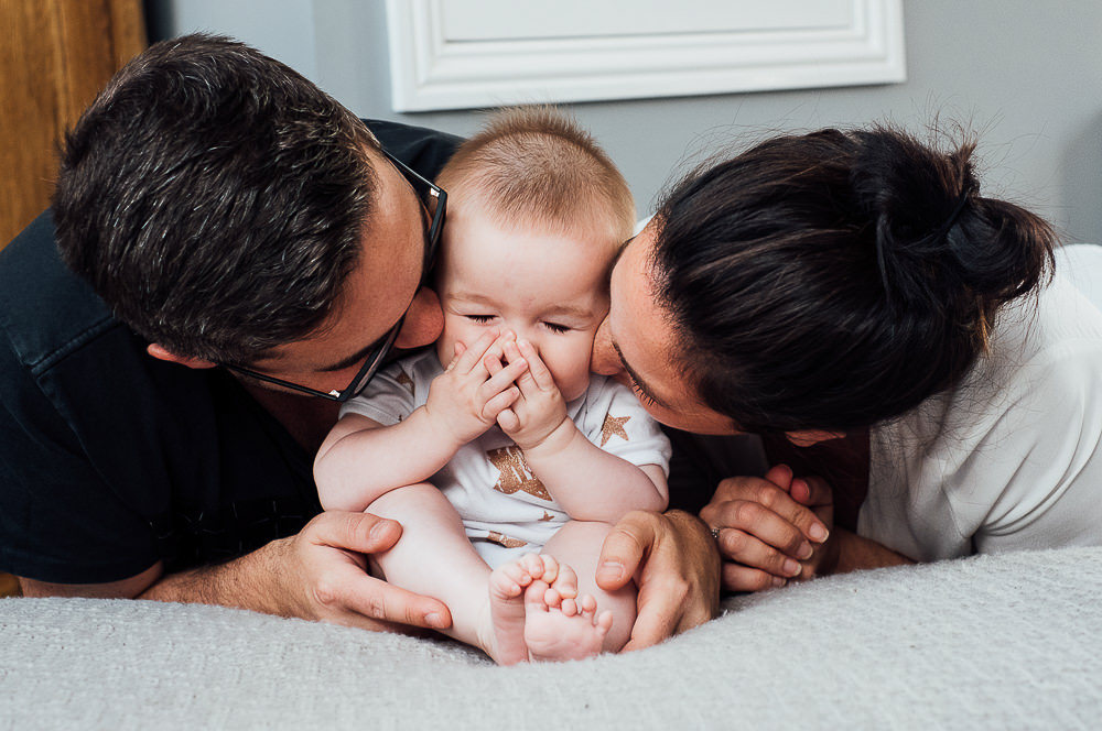 NEWBORN PHOTOGRAPHER LONDON AND KENT BABY KISSING HIDING MUM AND DAD PORTRAIT