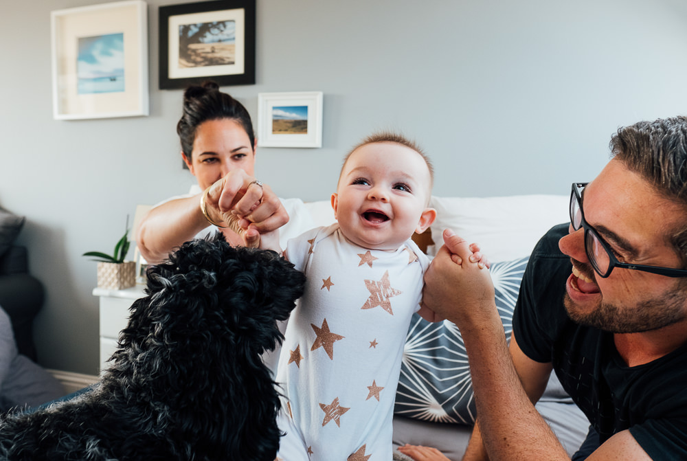 Surrey Family Photographer parents baby and dog on bed
