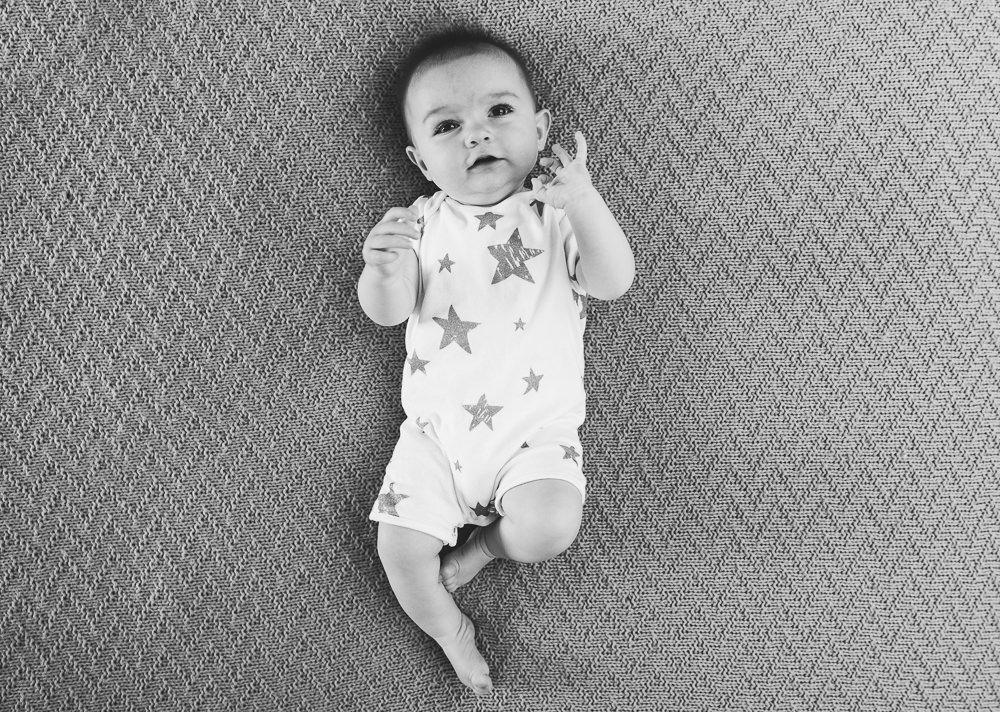 Godstone Surrey Family Photographer baby girl on bed smiling