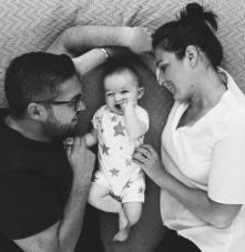 SURREY AND LONDON FAMILY PHOTOGRAPHER PARENTS AND BABY ON BED BLACK AND WHITE