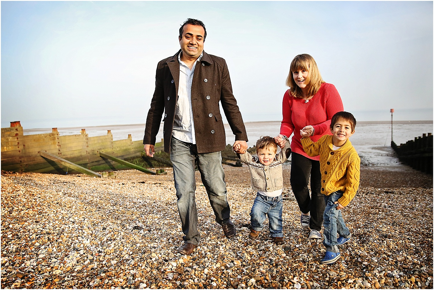 Whitstable beach photography family child walking early morning
